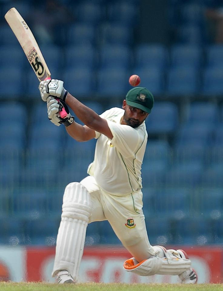 Bangladeshi cricketer Tamim Iqbal plays a shot during the third day of the second Test match between Sri Lanka and Bangladesh at the R. Premadasa Cricket Stadium in Colombo on March 18, 2013. AFP PHOTO/ LAKRUWAN WANNIARACHCHI
