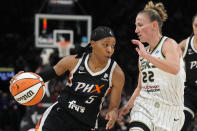 Phoenix Mercury guard Shey Peddy (5) drives on Chicago Sky guard Courtney Vandersloot during the first half of Game 2 of basketball's WNBA Finals, Wednesday, Oct. 13, 2021, in Phoenix. (AP Photo/Rick Scuteri)