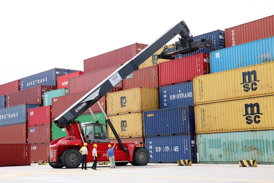 NANTONG, CHINA - JULY 18: A crane transfers a shipping container at Tonghai Port Area on July 18, 2019 in Nantong, Jiangsu Province of China. China's GDP expanded 6.3 percent year-on-year in the first half of this year, according to the National Bureau of Statistics on Monday. (Photo by Xu Congjun/Visual China Group via Getty Images)