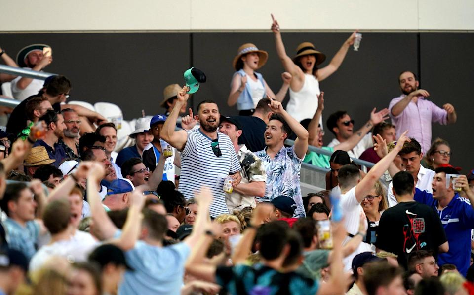 Spectators in the stands celebrate during The Hundred match at The Kia Oval, London. Picture date: Thursday July 22, 2021 - The Hundred debates booze-free zones at the Oval after rowdy scenes in opening men's match - PA