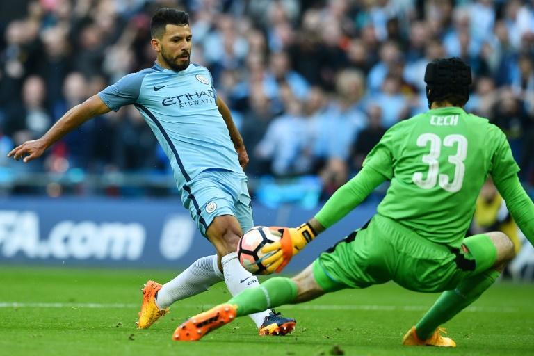 Manchester City's Sergio Aguero (L) scores a goal past Arsenal's goalkeeper Petr Cech during their FA Cup semi-final match, at Wembley stadium in London, on April 23, 2017