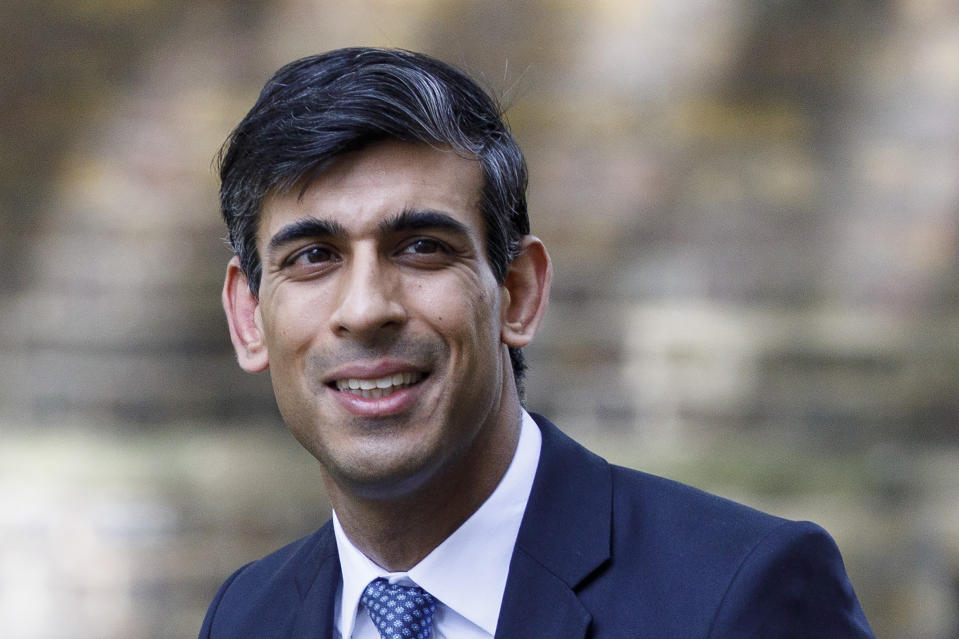 """Britain's Chancellor of the Exchequer Rishi Sunak arrives in Downing Street in central London May 18, 2020. - British health officials added loss of taste and smell to their coronavirus symptoms list on Monday after experts warned cases were being missed. """"From today, all individuals should self-isolate if they develop a new continuous cough or fever or anosmia,"""" Britain's chief medical officers said in a statement. (Photo by Tolga AKMEN / AFP) (Photo by TOLGA AKMEN/AFP via Getty Images)"""