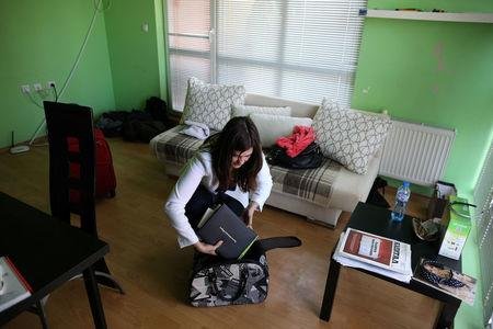 Bulgarian Yolcheva, a PR professional, prepares her luggage prior to her departure to London, in Sofia