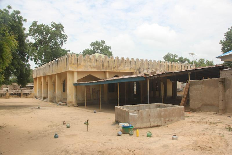 """In this photo taken Tuesday, Aug. 13, 2013, a deserted mosque that was attacked by gunmen in Konduga, Maiduguri, Nigeria. British Cabinet Minister Mark Simmonds on Tuesday condemned as """"contemptible and cowardly"""" an attack on a mosque in northeastern Nigeria in which suspected Islamic extremists killed at least 44 worshippers and wounded another 26. (AP Photo/Abdulkareem Haruna)"""