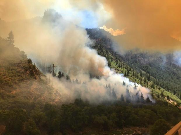 "Smoke from the Grizzly Creek fire billows over mountains. <p class=""copyright"">Inciweb</p>"