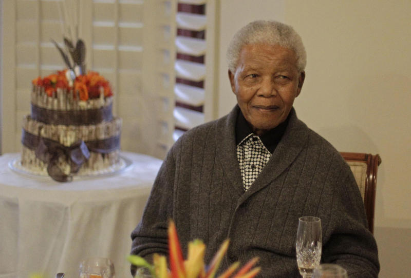 FILE - In this Wednesday, July 18, 2012 file photo, former South African President Nelson Mandela as he celebrates his 94th birthday with family in Qunu, South Africa. Nelson Mandela's health has deteriorated and he is now in critical condition, the South African government said Sunday, June 23, 2013. The office of President Jacob Zuma said in a statement that he had visited the 94-year-old anti-apartheid leader at a hospital on Sunday evening and was informed by the medical team that Mandela's condition had become critical in the past 24 hours. (AP Photo/Schalk van Zuydam, File)