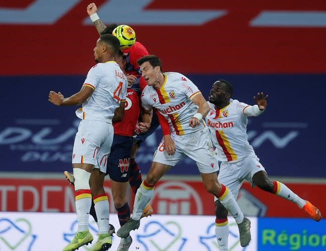 Leader Lille 2 points clear of PSG after beating Lens 4-0