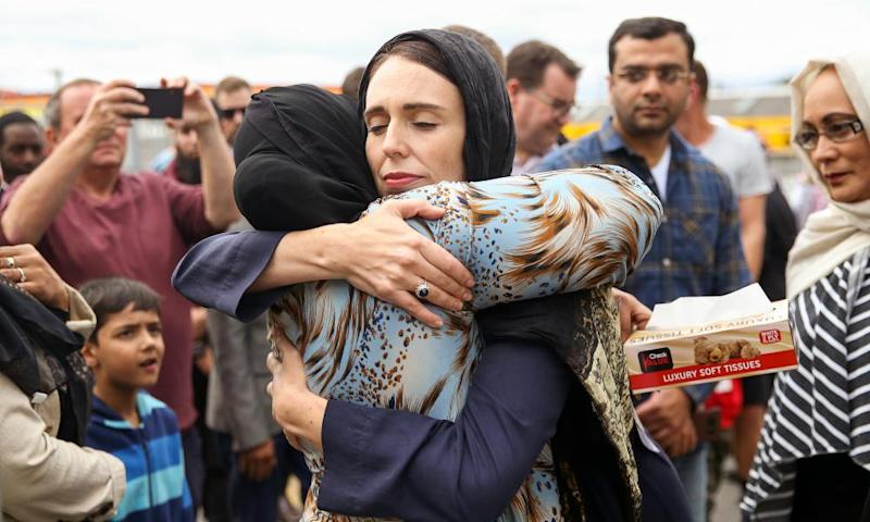 Ardern hugs a visitor at the Kilbirnie mosque after the Christchurch attacks