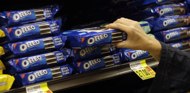 <p> FILE - In this Feb. 9, 2011 file photo, a shopper selects Oreo cookies at a Ralphs Fresh Fare supermarket in Los Angeles. Mondelez International Inc. reports quarterly financial results after the market closes on Wednesday, Aug. 7, 2013. (AP Photo/File)