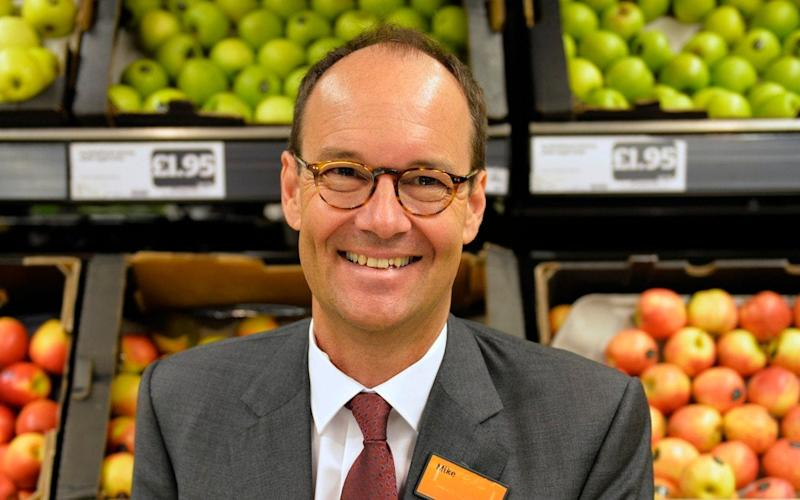 Mike Coupe, CEO of Sainsbury's, engaged in a 30 minute discussion with a customer about their use of plastic packaging  - PA
