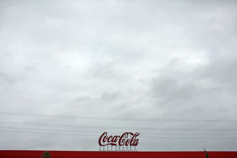 FILE PHOTO: Coca-Cola signage is pictured at a bottling plant near Seville