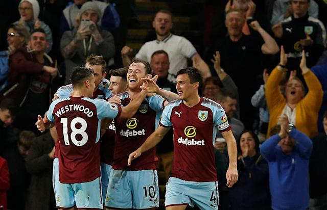 """Soccer Football - Premier League - Burnley vs Chelsea - Turf Moor, Burnley, Britain - April 19, 2018 Burnley's Ashley Barnes celebrates scoring their first goal with teammates REUTERS/Andrew Yates EDITORIAL USE ONLY. No use with unauthorized audio, video, data, fixture lists, club/league logos or """"live"""" services. Online in-match use limited to 75 images, no video emulation. No use in betting, games or single club/league/player publications. Please contact your account representative for further details."""