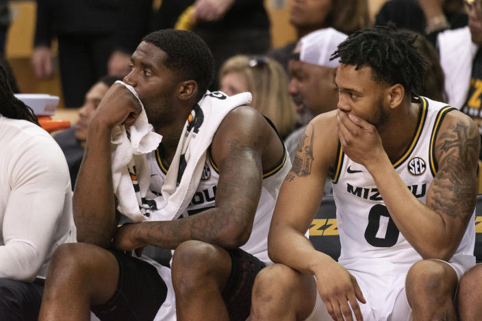 Missouri's Jeremiah Tilmon, left, and Torrence Watson, right, watch the second half of an NCAA college basketball game against Mississippi State from the bench Saturday, Feb. 29, 2020, in Columbia, Mo. Mississippi State won 67-63. (AP Photo/L.G. Patterson)