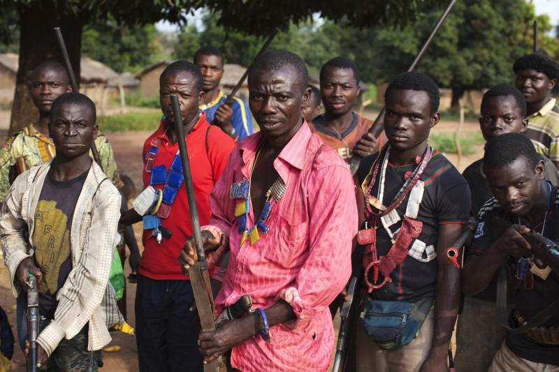 Militia fighters known as anti-balaka pose for a photograph in Mbakate village