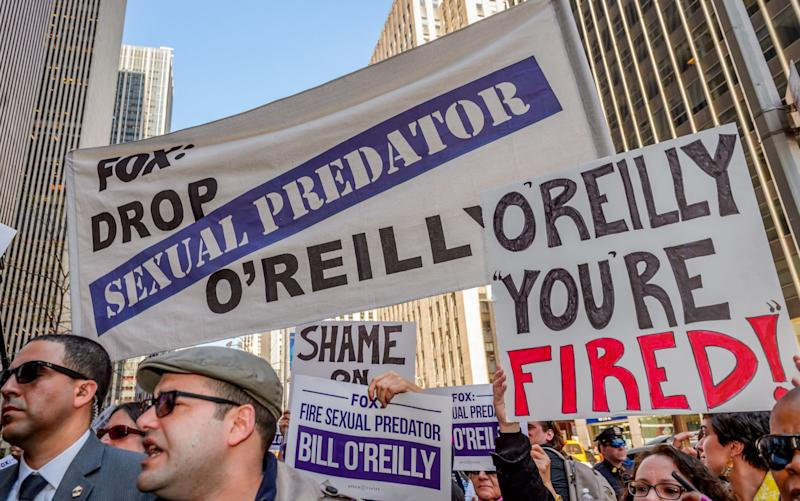 Women's group, Ultraviolet, organised a peaceful protest outside Fox News Headquarters in New York City, with survivors of sexual assault demanding that the network fire Bill O'Reilly and take steps to end the dangerous culture of sexual harassment at the news giant - Credit: Rex