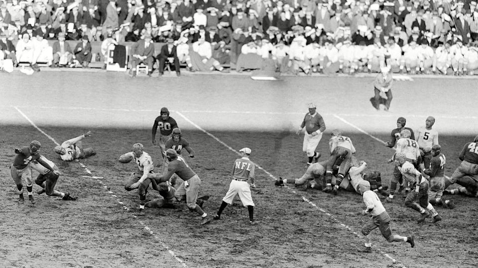 Mandatory Credit: Photo by AP/REX/Shutterstock (6032000b)Cecil Isbell Cecil Isbell (17), Green Bay halfback, hits the line for a ten-yard gain in the first quarter at the Polo Grounds as the New York Giants defeated the Green Bay Packers in their National Professional Football game in New YorkGiants Green Bay, New York, USA.