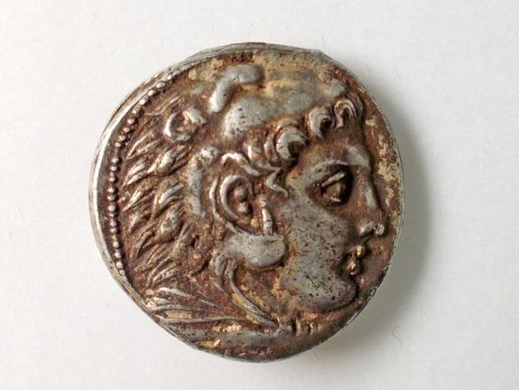 The face of Heracles on a coin found at the farmhouse suggests the Greeks had influence over the area 2,800 years ago.