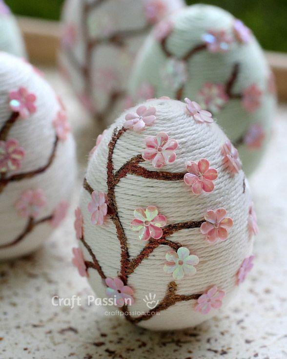 "<p>Turn your eggs into flowering cherry blossom trees with yarn and pink sequins.</p><p><strong>Get the tutorial at <a href=""http://www.craftpassion.com/2014/03/sakura-easter-eggs.html"" rel=""nofollow noopener"" target=""_blank"" data-ylk=""slk:Craft Passion"" class=""link rapid-noclick-resp"">Craft Passion</a>.</strong></p>"