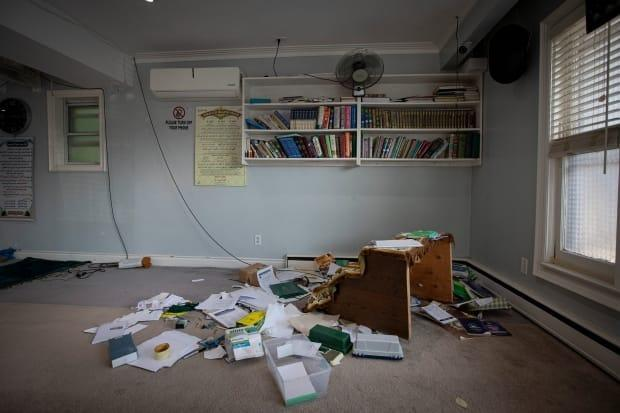 Ransacked paperwork and religious texts left on the floor of the Baitul Jannah Islamic Centre are pictured on Aug. 23, 2021. The mosque was broken into and vandalized over the weekend. (Evan Mitsui/CBC - image credit)