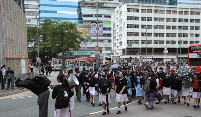 As students across Hong Kong return to school, about 100 of them took the streets in Kwun Tong. Photo: Xiaomei Chen