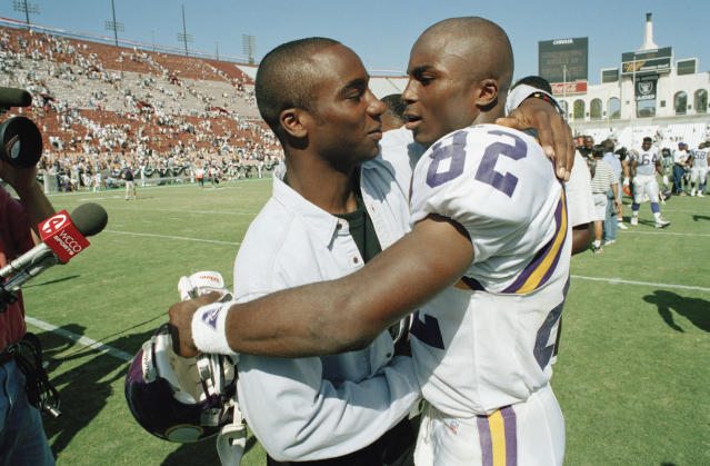 "Raghib ""Rocket"" Ismail (L) hugs his brother, Qadry, after an NFL game. The brothers' two schools, Notre Dame and Syracuse, play each other on Saturday. (AP)"