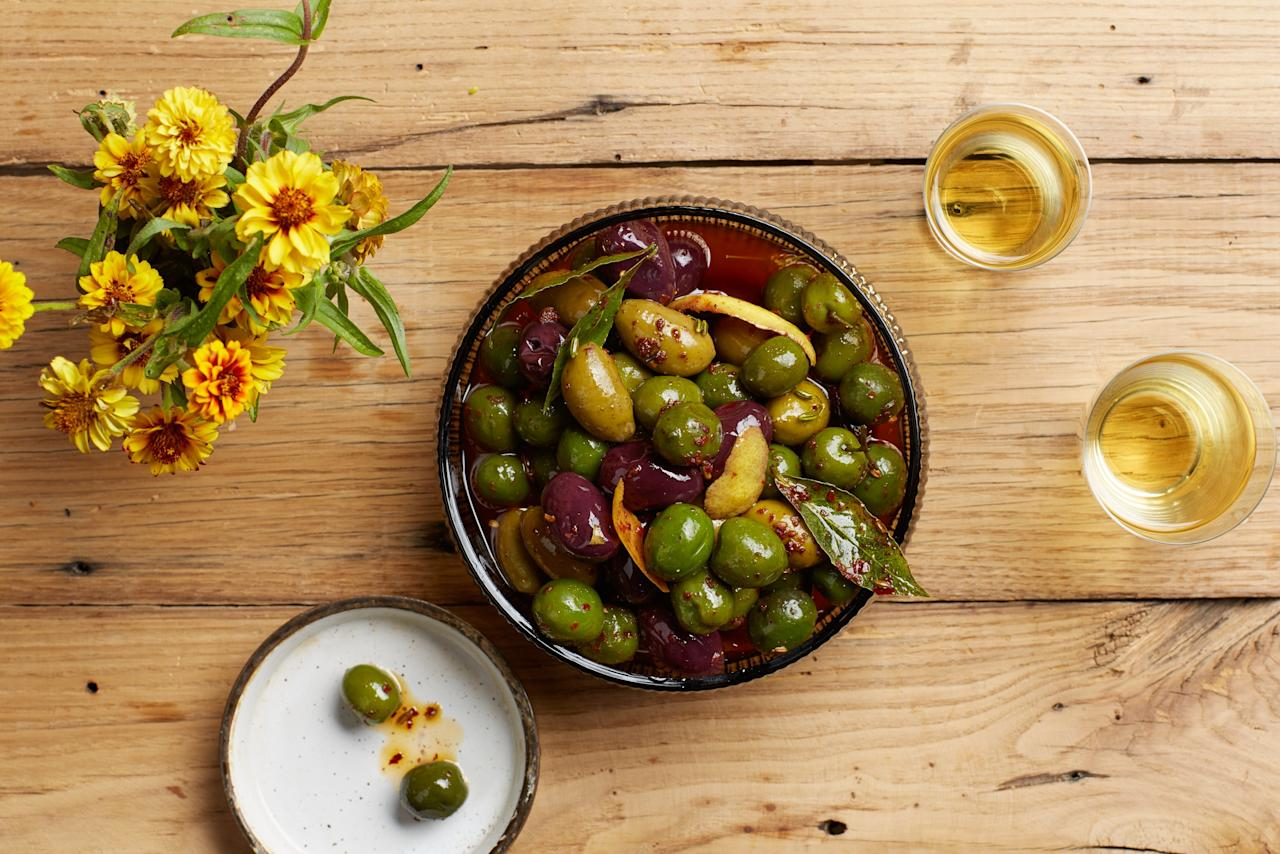 """A warm, richly spiced oil turns a bowl of mixed olives into elegant party fare. Always an easy gluten-free appetizer idea, no matter the occasion. <a href=""""https://www.epicurious.com/recipes/food/views/warmed-spiced-olives?mbid=synd_yahoo_rss"""">See recipe.</a>"""