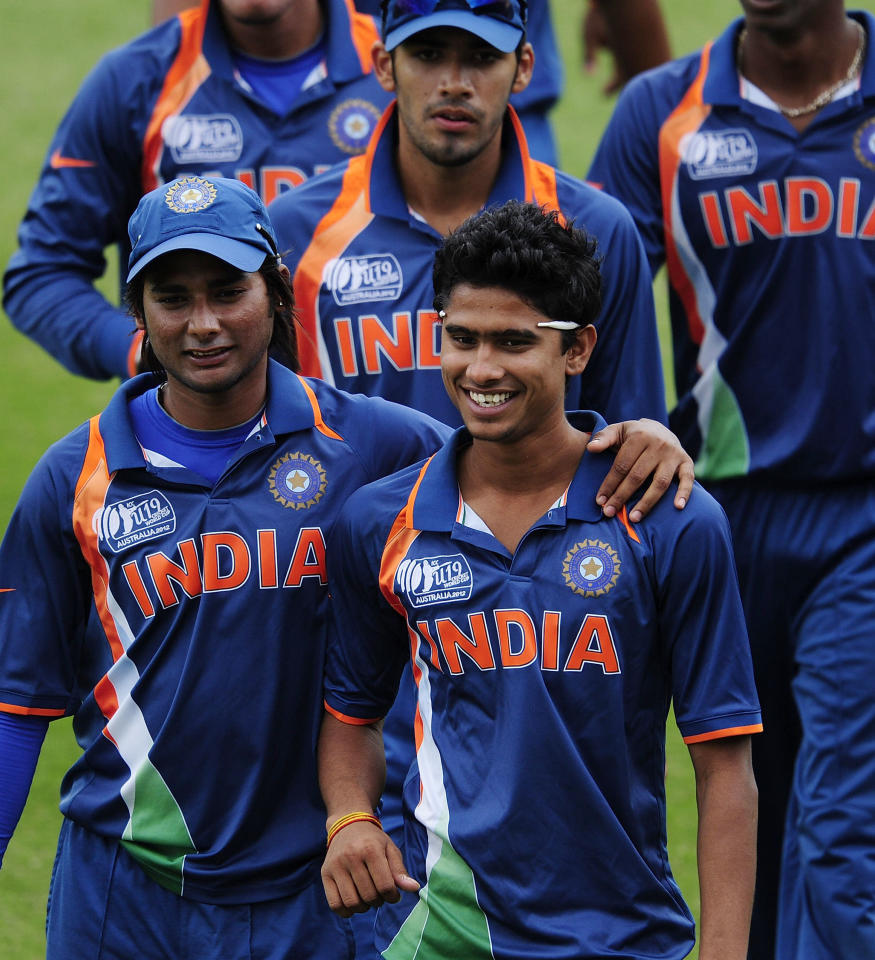 TOWNSVILLE, AUSTRALIA - AUGUST 20:  Kamal Passi (L) and Ravikant Singh of India walk from the field during the innings break during the ICC U19 Cricket World Cup 2012 Quarter Final match between India and Pakistan at Tony Ireland Stadium on August 20, 2012 in Townsville, Australia.  (Photo by Ian Hitchcock-ICC/Getty Images)