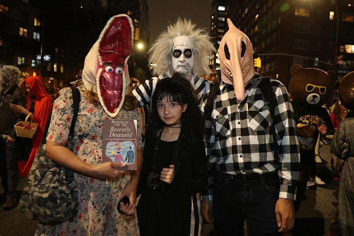 "People dressed as characters from the movie ""Beetlejuice"" participate in the Village Halloween Parade in New York City. (Photo: Gordon Donovan/Yahoo News)"