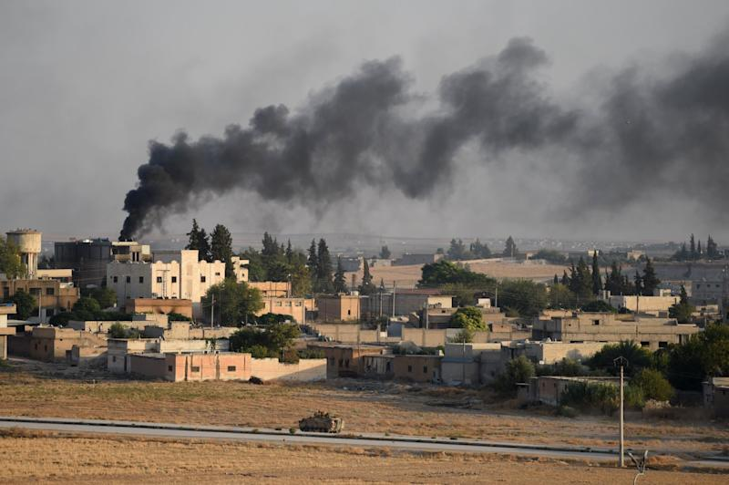 A Turkish army armored vehicle advances in Syrian city of Tel Abyad, as seen from the Turkish border town of Akcakale on October 13, 2019 in Akcakale, Turkey. The military action is part of a campaign to extend Turkish control of more of northern Syria, a large swath of which is currently held by Syrian Kurds, whom Turkey regards as a threat. U.S. President Donald Trump recently ordered the withdrawal of U.S. troops from several Syrian outposts near the Turkish border.