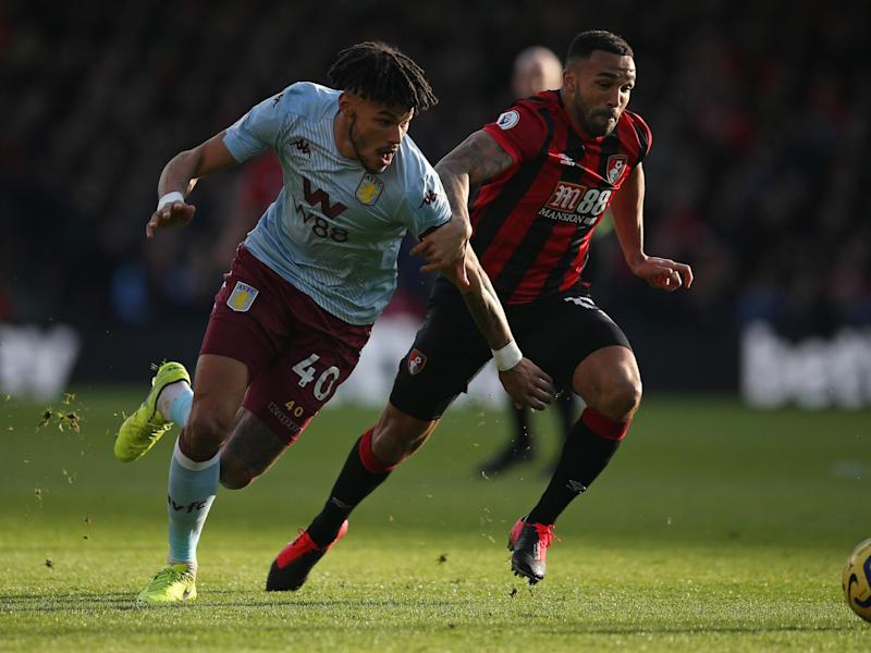 Tyrone Mings of Aston Villa battles for possession with Callum Wilson of AFC Bournemouth: Getty Images