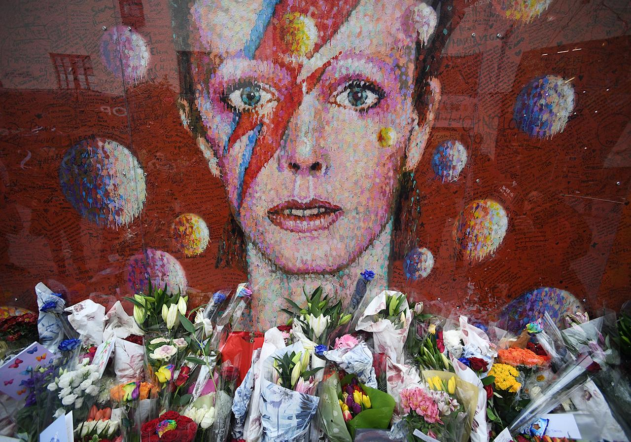 <p>Flowers and tributes are placed by an art work of David Bowie, on his first death anniversary in Brixton, London, Britain, Jan. 10, 2017. David Bowie would have turned 70 on Jan. 8, 2017. He died on Jan. 10, 2016 after a battle with cancer. Photo: FACUNDO ARRIZABALAGA/EPA) </p>