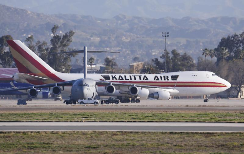In this Wednesday, Jan. 29, 2020, file photo an airplane carrying U.S. citizens being evacuated from Wuhan, China, lands at March Air Reserve Base in Riverside, Calif. One of the 195 Americans evacuated from the virus outbreak zone in China and housed at a California military base for three days of monitoring tried to leave the base and was placed under quarantine, an official said Thursday, Jan. 30: (AP Photo/Ringo H.W. Chiu,File)