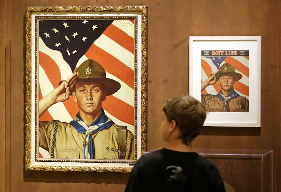 In this July 22, 2013, file photo, a youth looks over the Rockwell exhibition in Salt Lake City. (Photo: Rick Bowmer/AP)