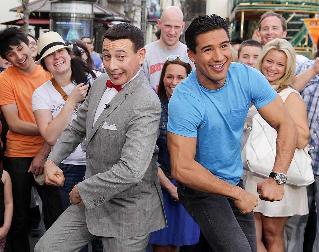 "Paul Reubens -- whose HBO special ""The Pee-wee Herman Show on Broadway"" premieres March 19 -- led ""Extra's"" Mario Lopez in his trademark dance Wednesday in L..A. ""Pee Wee Herman and I doing his little dance! He still makes me laugh.. Got a lot going on. Congrats!"" tweeted Lopez during the show. Noel Vasquez/<a href=""http://www.gettyimages.com/"" target=""new"">GettyImages.com</a> - March 9, 2011"