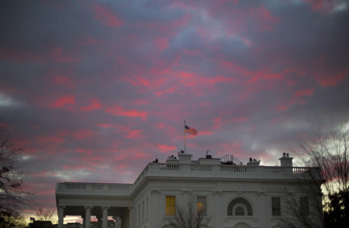 <p> FILE - In this Jan. 27, 2017, file photo, day breaks over the White House in Washington. Two weeks into his presidency, Donald Trump has thrown Washington into a state of anxious uncertainty. Policy pronouncements sprout up from the White House in rapid succession. Some have far-reaching implications, most notably Trump's temporary refugee and immigration ban, but others disappear without explanation, including planned executive actions on cybersecurity and the president's demand for an investigation into unsubstantiated voter fraud. The day's agenda can quickly be overtaken by presidential tweets, which often start flashing on smartphones just as the nation's capital is waking up. (AP Photo/Pablo Martinez Monsivais, File) </p>