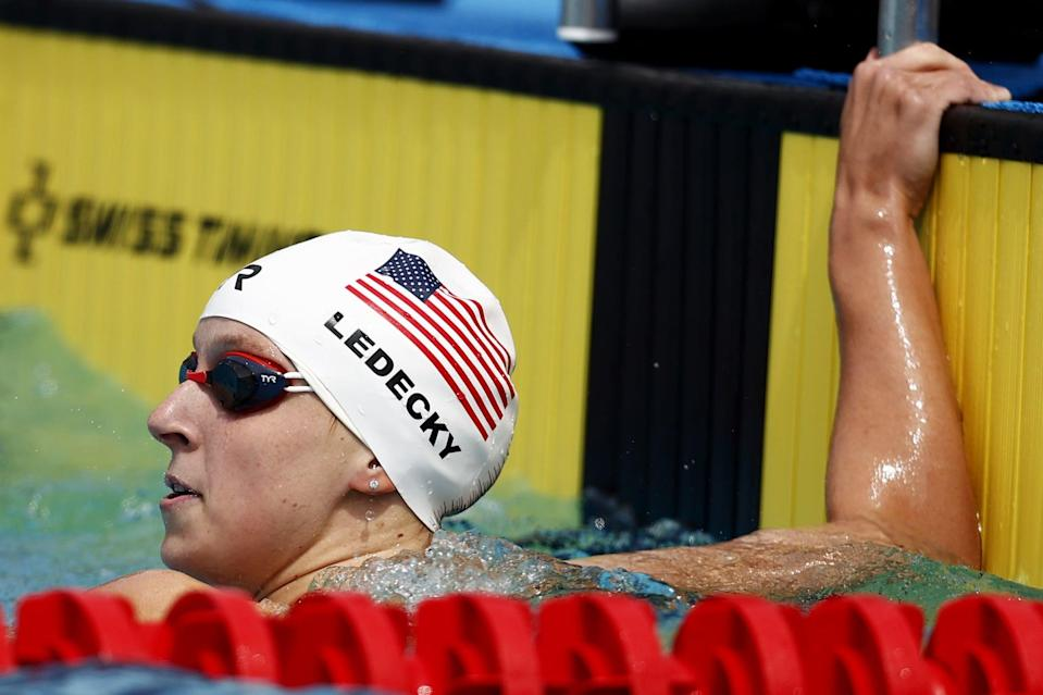 MISSION VIEJO, CALIFORNIA - APRIL 11: Katie Ledecky looks on after competing in the Women's 100 Meter Freestyle Final on Day Four of the TYR Pro Swim Series at Mission Viejo at Marguerite Aquatics Center on April 11, 2021 in Mission Viejo, California.   (Photo by Maddie Meyer/Getty Images)