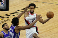 Portland Trail Blazers guard Rodney Hood, right, passes off against Sacramento Kings center Hassan Whiteside, second from left, during the second quarter of an NBA basketball game in Sacramento, Calif., Wednesday, Jan. 13, 2021. (AP Photo/Rich Pedroncelli)