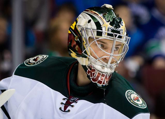 Minnesota Wild goalie Darcy Kuemper pauses during a stoppage in the first period of an NHL hockey game against the Vancouver Canucks, Friday, Feb. 28, 2014, in Vancouver, British Columbia. (AP Photo/The Canadian Press, Darryl Dyck)