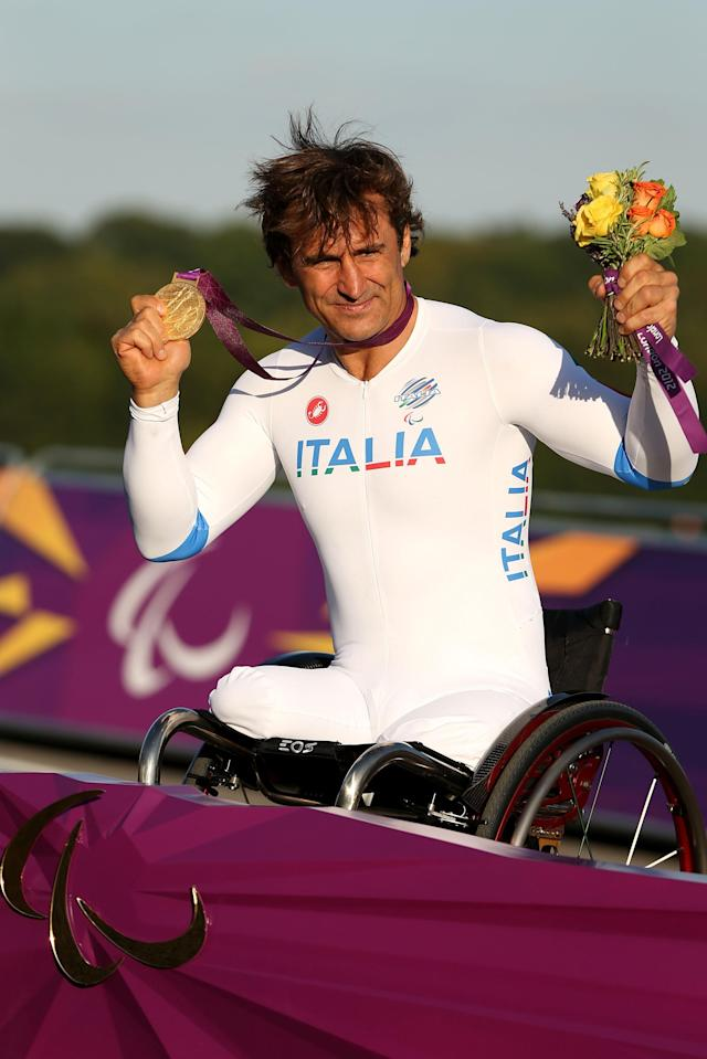 LONGFIELD, ENGLAND - SEPTEMBER 05: Alessandro Zanardi of Italy celebrates on the podium with his Gold medal after winning the Men's Individual H4 Time Trialon day 7 of the London 2012 Paralympic Games at Brands Hatch on September 5, 2012 in Longfield, England. (Photo by Bryn Lennon/Getty Images)