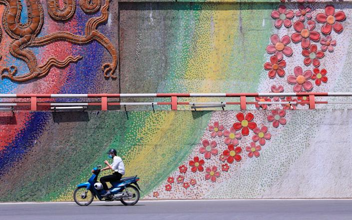 Normally bustling city streets have emptied out - Hau Dinh/AP