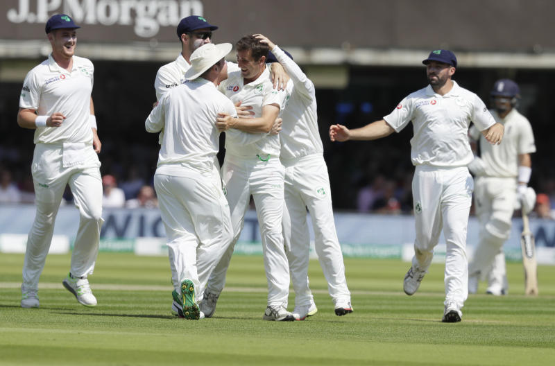 Ireland's Tim Murtagh celebrates taking his fifth wicket, the wicket of England's Moeen Ali during the first day of the test match between England and Ireland at Lord's cricket ground in London, Wednesday, July 24, 2019. (AP Photo/Kirsty Wigglesworth)