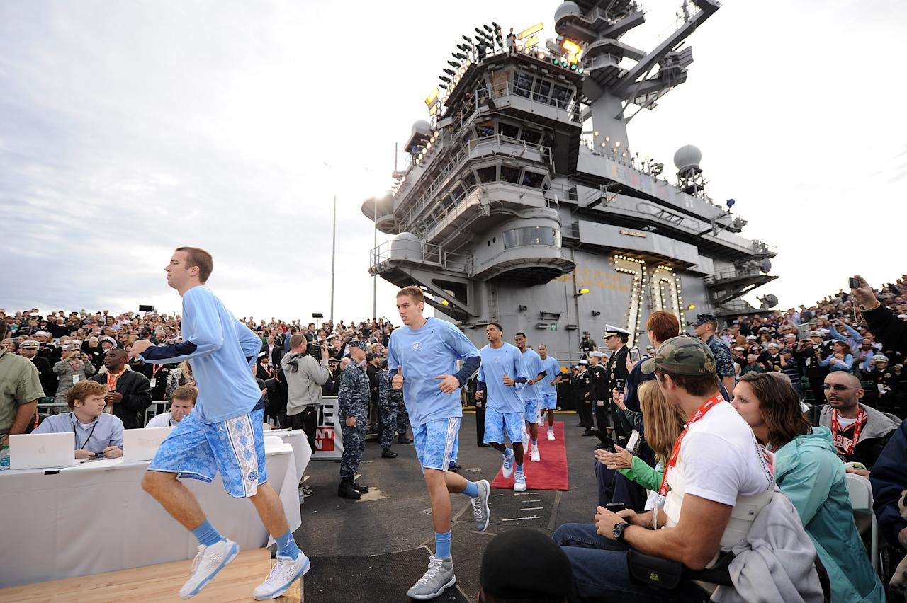 SAN DIEGO, CA - NOVEMBER 11:  The North Carolina Tar Heels run out to the court before taking on the Michigan State Spartans during the NCAA men's college basketball Carrier Classic aboard the flight deck of the USS Carl Vinson on November 11, 2011 in San Diego, California.  (Photo by Harry How/Getty Images)