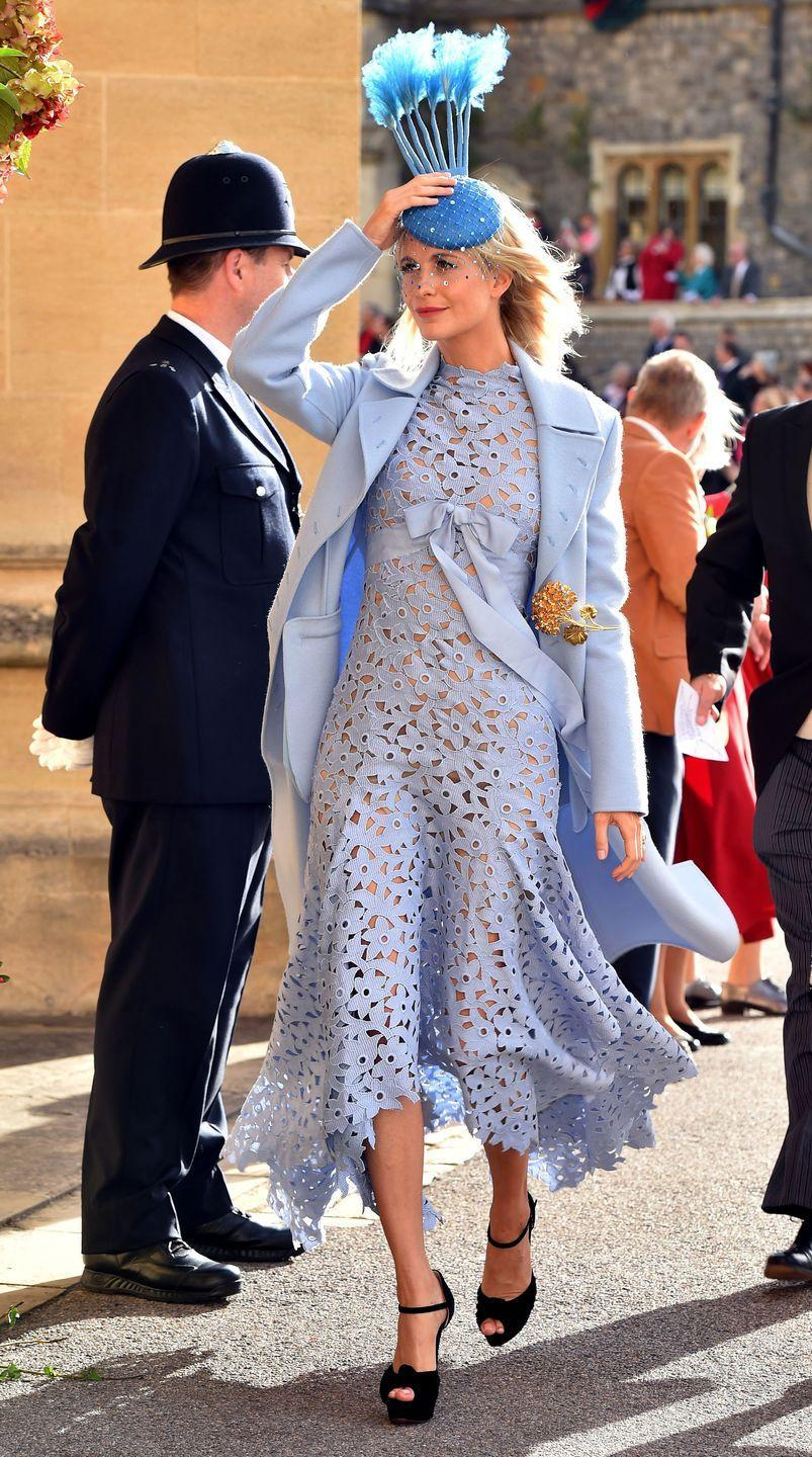 <p>Poppy Delevingne wore a vibrant blue feathered hat while attending Princess Eugenie's wedding. </p>