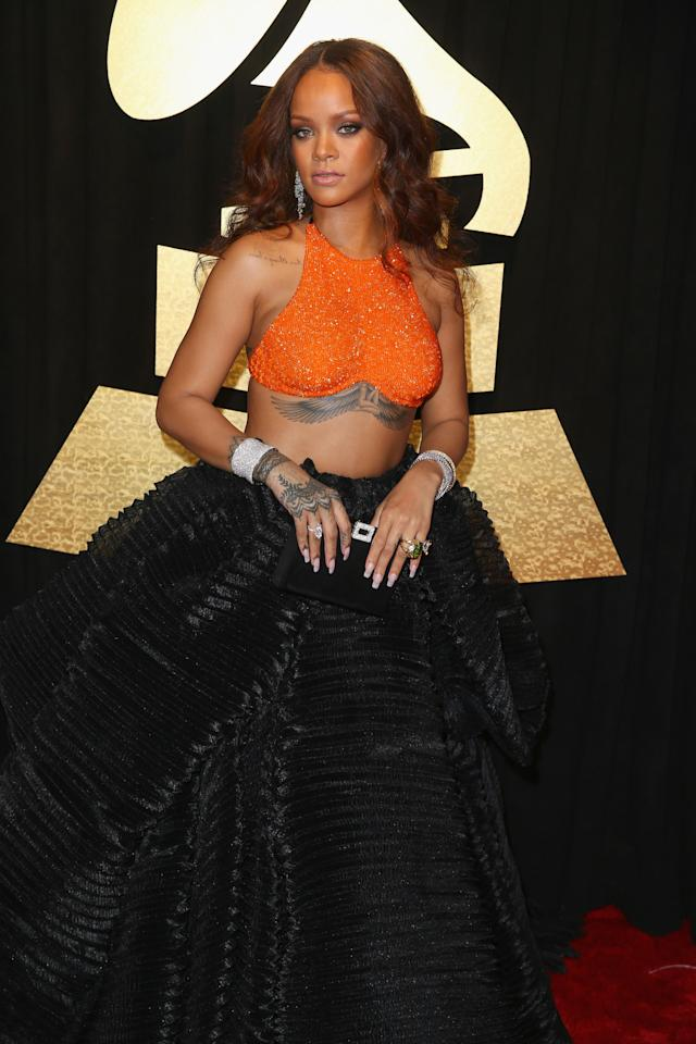 <p>RiRi's bra top revealed her chest and back ink. (Photo: Getty Images) </p>
