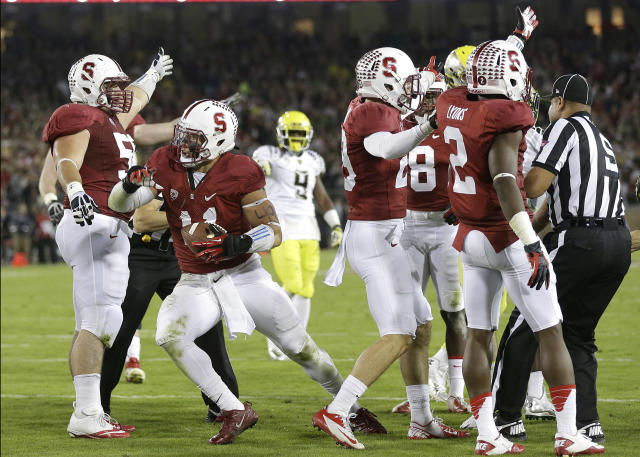 Stanford linebacker Shayne Skov, second from left, celebrates with teammates after recovering a fumble by Oregon running back De'Anthony Thomas during the first half of an NCAA college football game in Stanford, Calif., Thursday, Nov. 7, 2013. (AP Photo/Marcio Jose Sanchez)