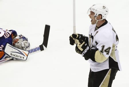 Pittsburgh Penguins' Kunitz celebrates his overtime goal against the New York Islanders' Nabokov during their Stanley Cup playoffs Eastern Conference quarter-final game in Uniondale