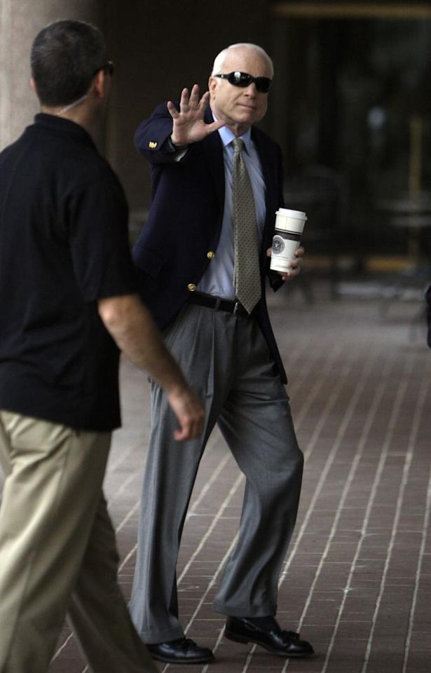 Republican presidential candidate Sen. John McCain, R-Ariz., carries a cup of coffee as he walks into his campaign headquarters in Arlington, Va., Sunday, June 15, 2008. (AP/LM Otero)