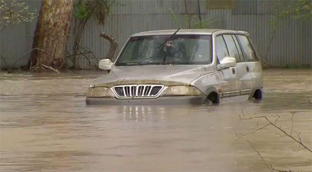 Cars were caught in the floodwaters. Source: 7News