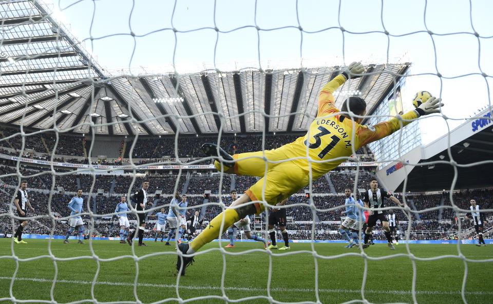 NEWCASTLE UPON TYNE, ENGLAND - NOVEMBER 30: City goalkeeper Edderson dives in vain as a shot from Newcastle player Jonjo Shelvey (c) sails into the net for the 2nd Newcastle goal during the Premier League match between Newcastle United and Manchester City at St. James Park on November 30, 2019 in Newcastle upon Tyne, United Kingdom. (Photo by Stu Forster/Getty Images)