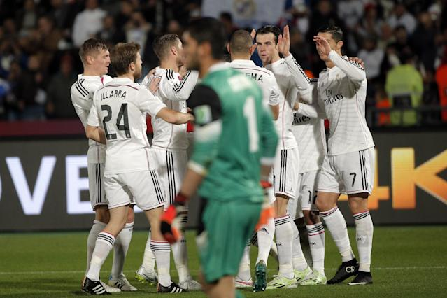 Real Madrid's Gareth Bale, second right, celebrates with teammates after scoring during the semifinal soccer match between Real Madrid and Cruz Azul at the Club World Cup soccer tournament in Marrakech, Morocco, Tuesday, Dec. 16, 2014. (AP Photo/Christophe Ena)
